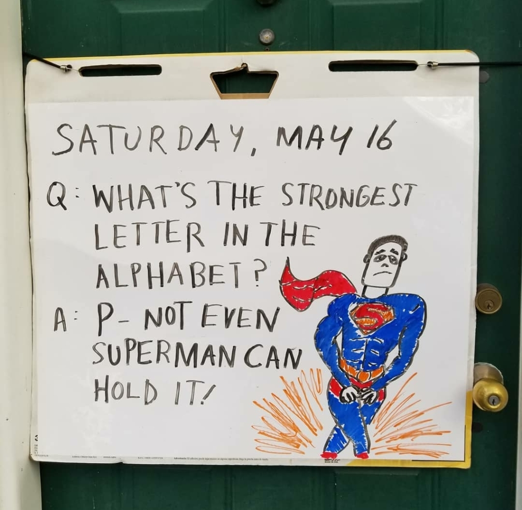 """Whiteboard illustration on a green door of Superman with his legs crossed, text reading """"Q: What's the strongest letter in the alphabet? A: P - Not even Superman can hold it."""""""